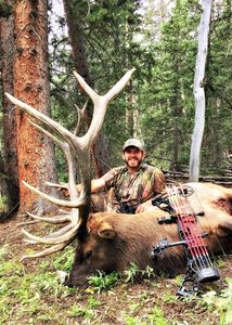 When he's not behind the camera, he's CRUSHING giant elk in front of it!